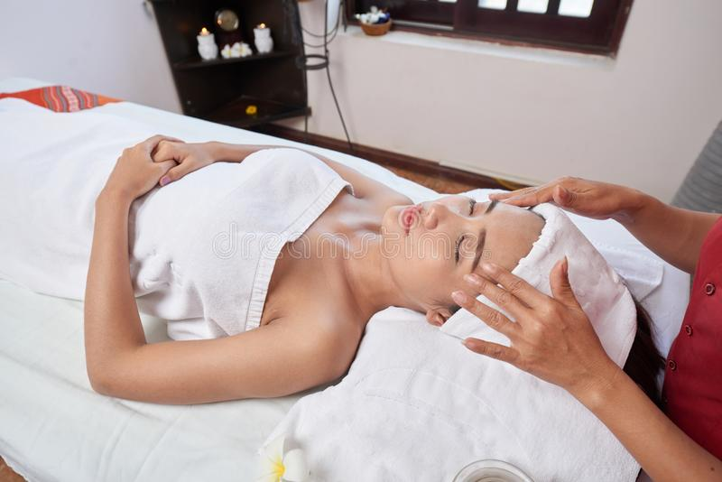 Relaxing spa procedure stock images