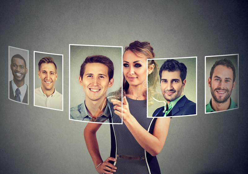 Beautiful woman undecided which man to choose stock photos
