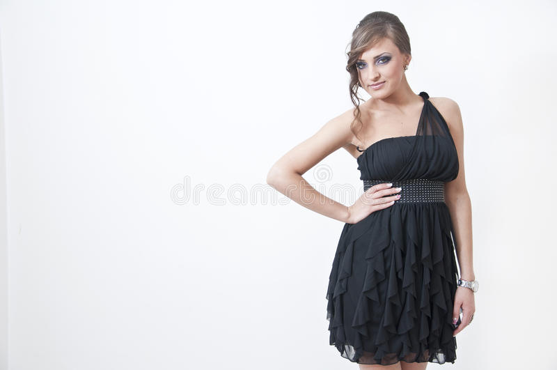 Beautifulgirl no vestido do baile de finalistas imagens de stock