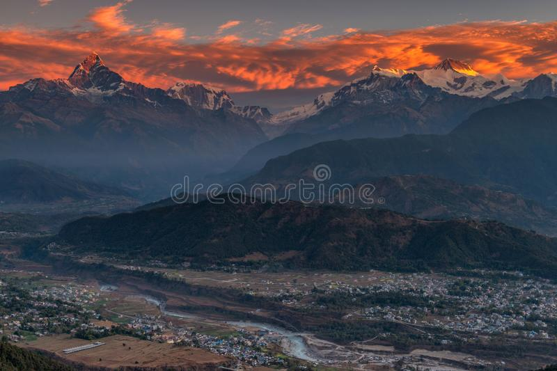 Beautifull cloudy sunrise in the mountains with snow ridge fron Himalaya view point. Pokhara Nepal royalty free stock photography