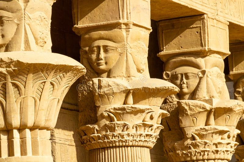 Upper column decoration at the courtyard of the temple of Philae stock photos
