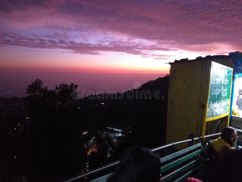 Beautifull evening pink sky cloudy in mussorie uttrakhand library chowk clicked on 15 november 2019 royalty free stock images