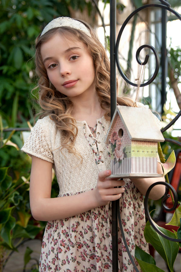Beautifull girl with nesting box. Vintage stock photography