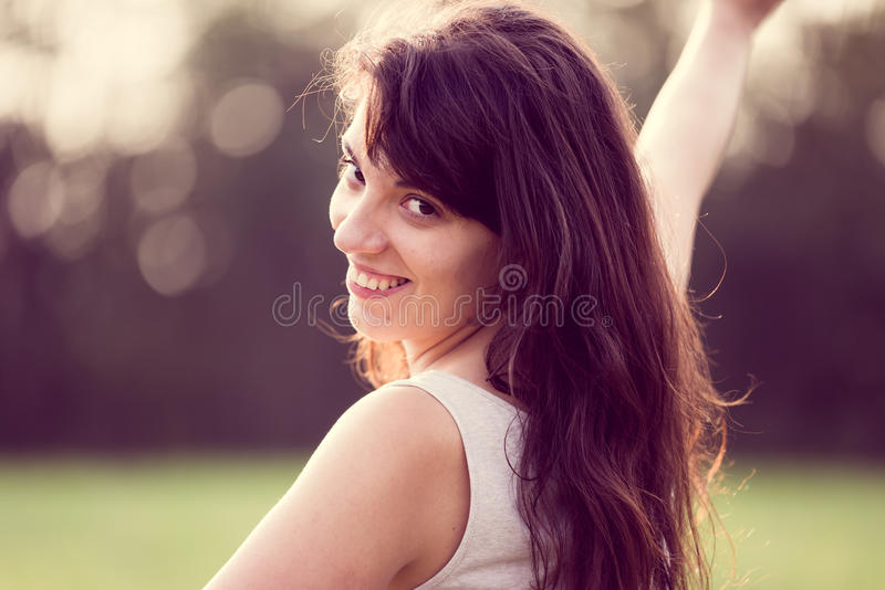 Beautifull happy smiling girl with long black hair in a garden stock image