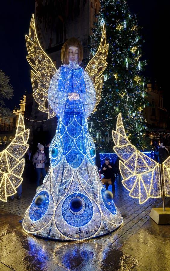 Beautifull illuminated Angel as Christmas decorations on Main Market Square in Krakow, Poland stock images