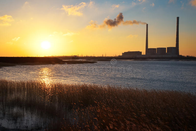 Beautifull landscape with thermal power plant, lake and sunset stock photo
