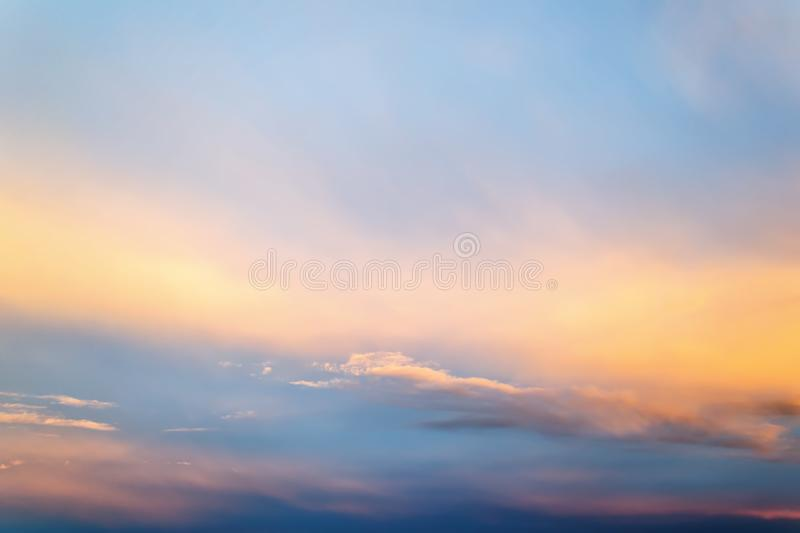 Beautifull skyscape at evening. Blue clear sunset sky with white and orange clouds. Calm background royalty free stock photography