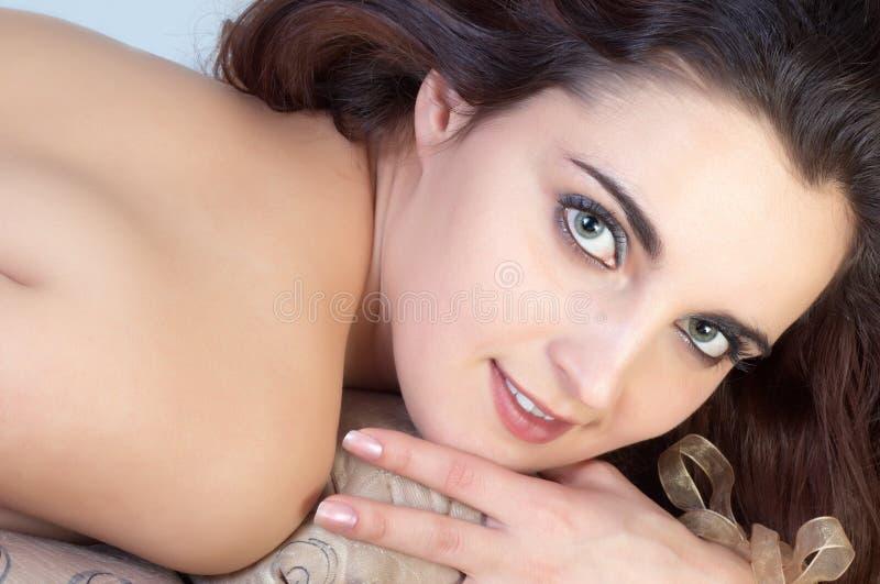 Beautifull topless girl. Beautiful topless girl lying on sofa stock photos