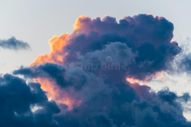 Beautifully colored cloud formation during sunset stock photos