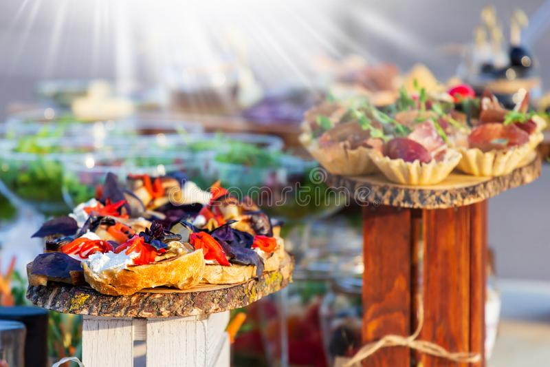 Beautifully decorated catering banquet table with different food snacks and appetizers on corporate christmas birthday party event stock photography