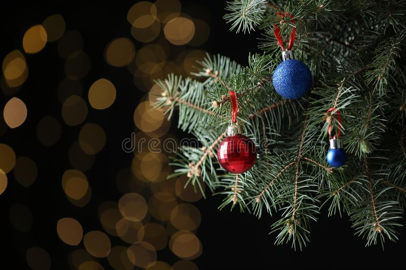 Beautifully decorated Christmas tree against blurred lights royalty free stock image