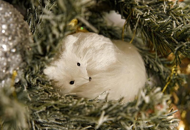 Beautifully decorated Christmas tree. White sleeping fox Christmas toy stock photo