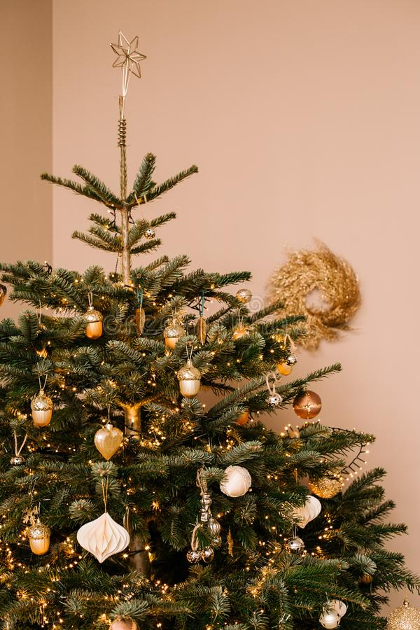 Beautifully decorated Christmas tree with wonderful gold toys. Christmas mood royalty free stock photos