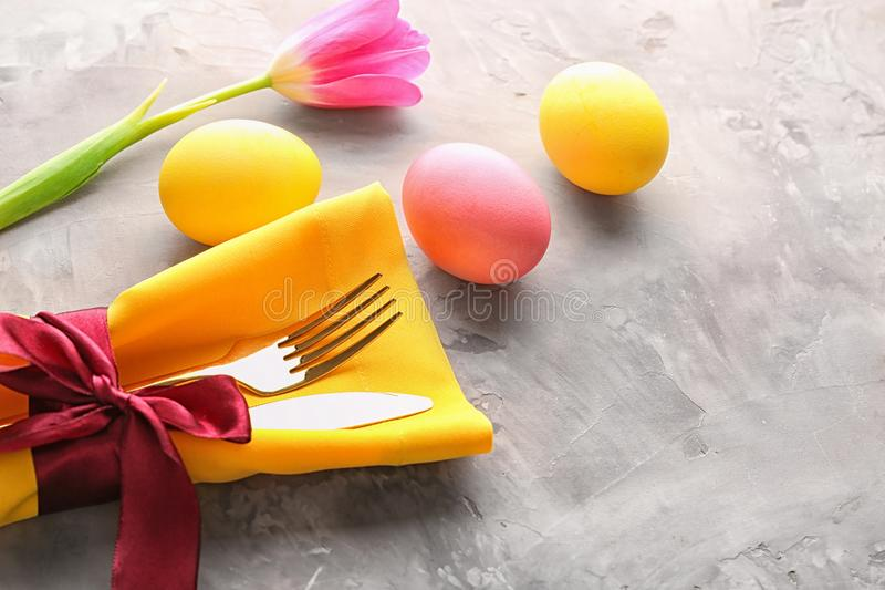 Beautifully decorated cutlery and painted eggs stock photo