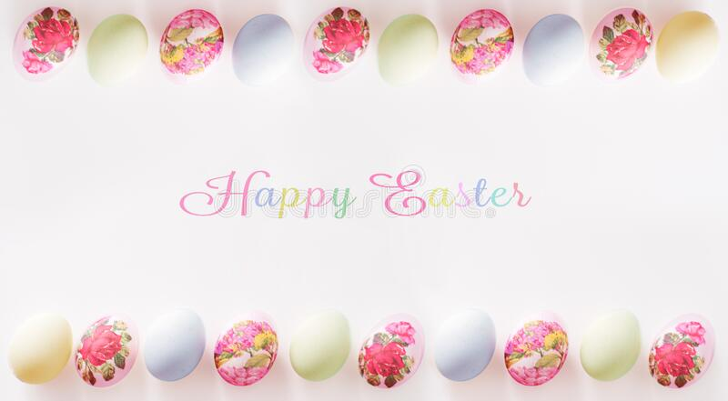 Beautifully decorated Easter eggs on white background with copy space; decoupage technique. Easter card.  royalty free stock photos