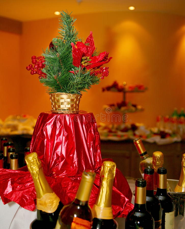 Beautifully decorated festive table at the buffet in the restaurant with christmas tree on the table royalty free stock photos