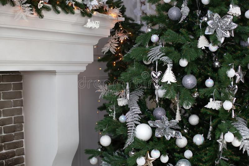 Beautifully decorated green christmas tree in living room. Christmas tree background and Christmas decorations with balls by firep. Lace, sparkling, glowing stock photo