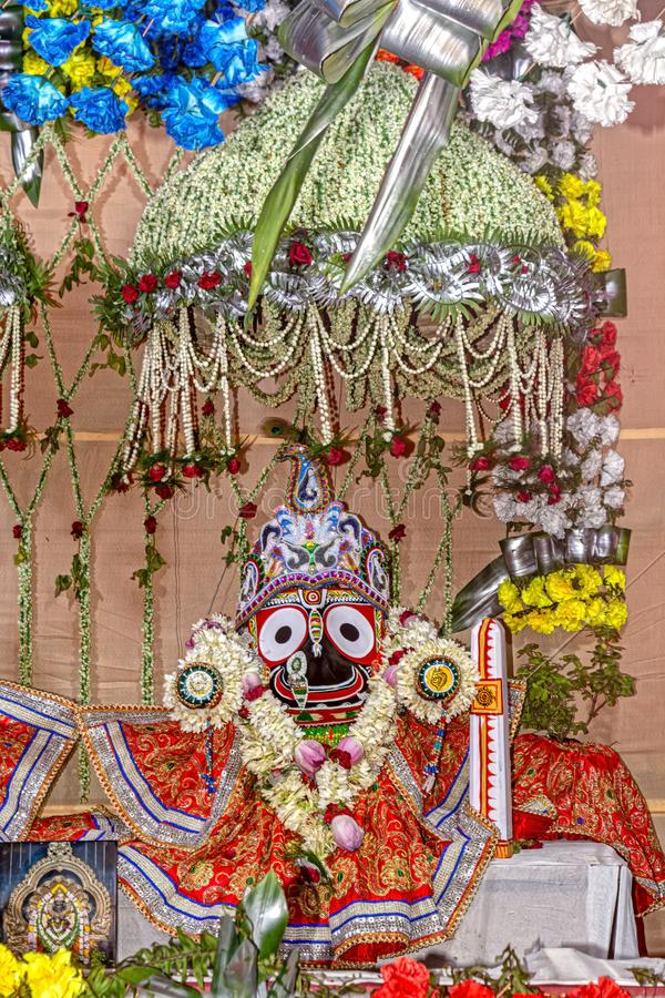 Beautifully decorated Hindu Lord Jagannath idol during the Rath Yatra Festival. Close up view of Beautifully decorated Hindu Lord Jagannath idol during the Rath royalty free stock photo