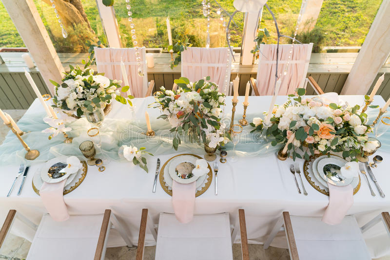 Beautifully decorated table with flowers stock images