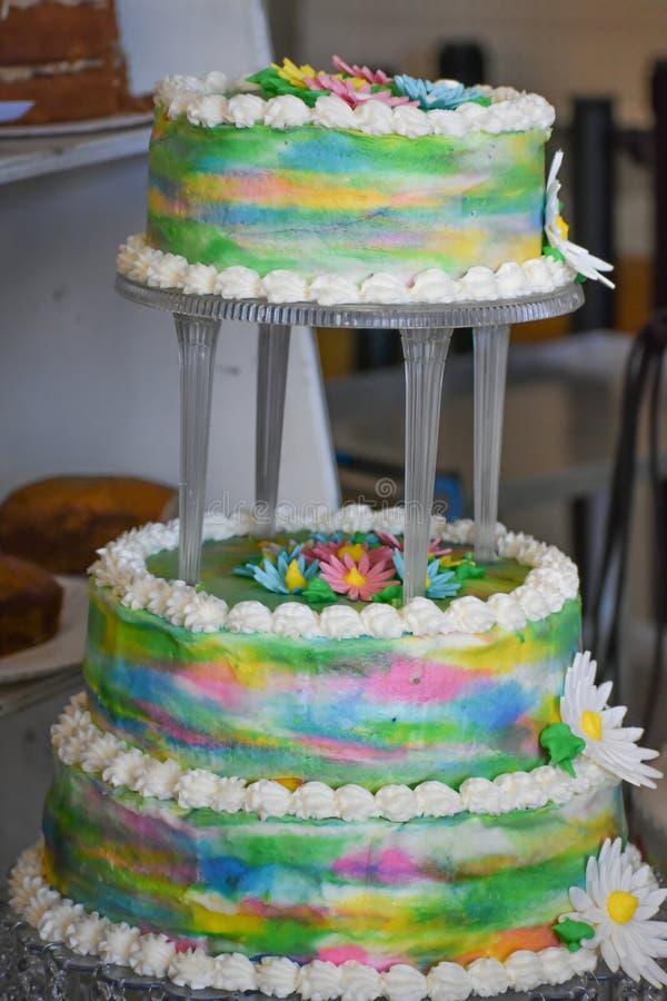 Rainbow Wedding Cake with Flowers stock photography