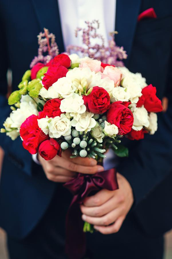 Beautifully decorated wedding bouquet of white and red royalty free stock photo