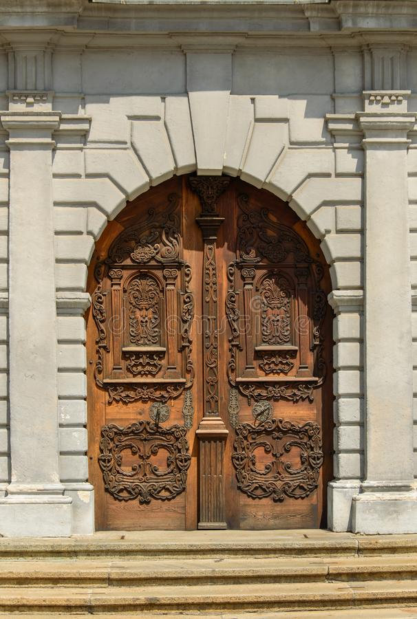 Beautifully decorated wooden door to the church royalty free stock photo