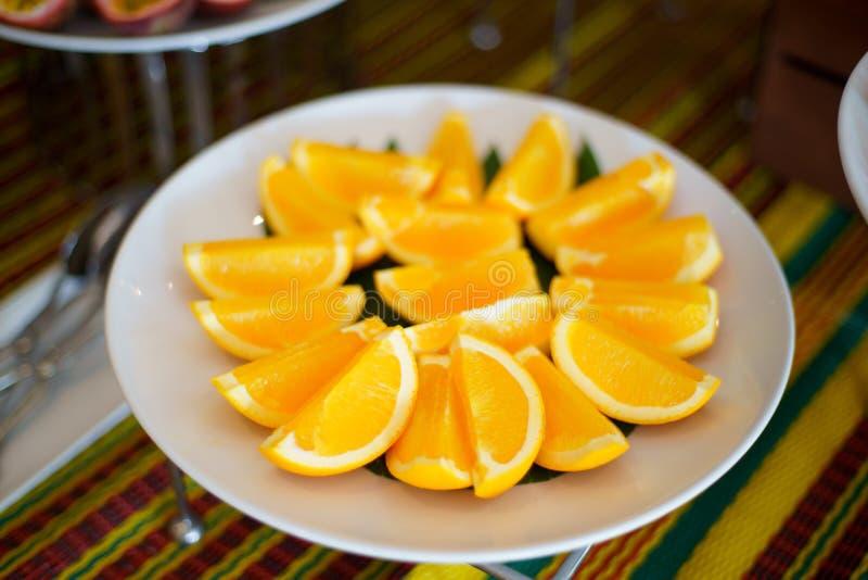 Beautifully Fresh Sliced orange on white plate royalty free stock image