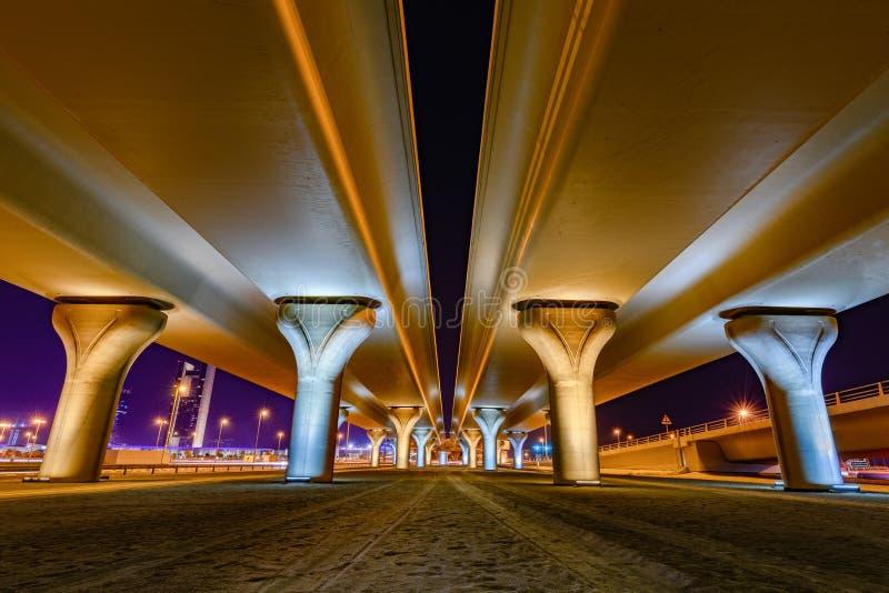 Beautifully illuminated flyover pillars at night stock image
