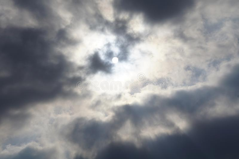 Beautifully Murky Cloudscapes. I can`t keep my eyes off the sky when it is cloudy and the sun travels through stock photo