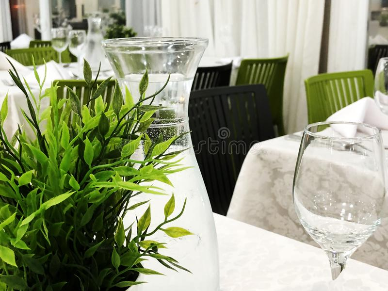 Beautifully organized event - served festive white tables ready for guests. Banquet, wedding decor, celebration. royalty free stock image