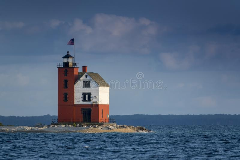 Beautifully painted Historic Round Island Lighthouse Mackinac Island Michigan. This beautifully restored Historic Round Island Lighthouse on Mackinac Island royalty free stock image