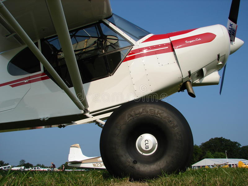 Beautifully restored Piper Pa-18 Super Cub on huge Alaska tundra tires. stock images