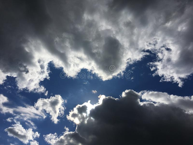 Beautifully Scary Clouds, Blue Sky. Beautiful Clouds With Spooky Shadows and a Bright Blue Sky! Great Background Picture royalty free stock image