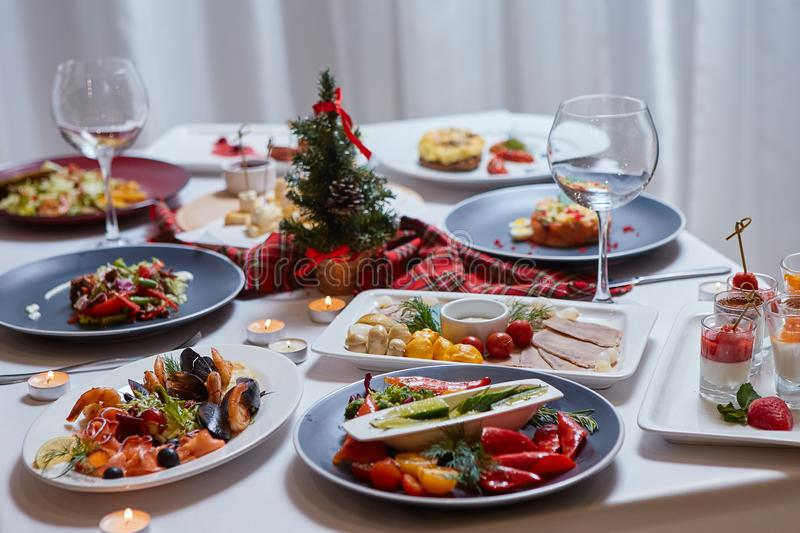 Beautifully served table with food. Festive atmosphere and decor. Celebration together.  royalty free stock image