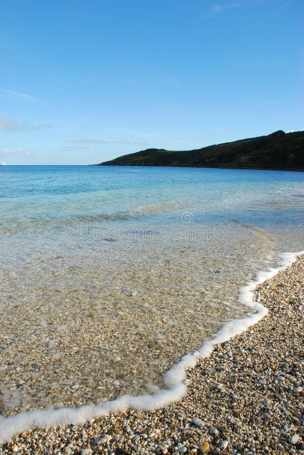 A beautifully sunny day on a Cornish beach royalty free stock images