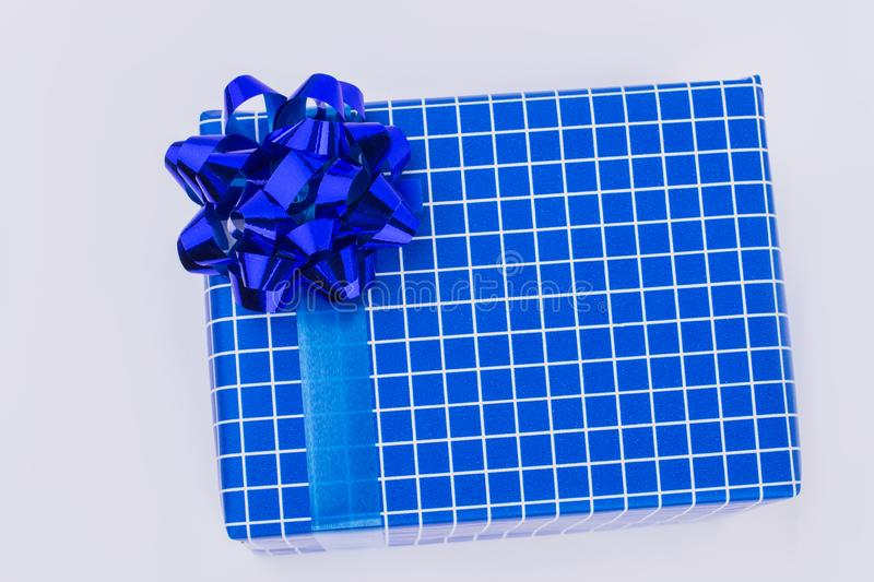 Beautifully wrapped blue patterned gift box. stock photo