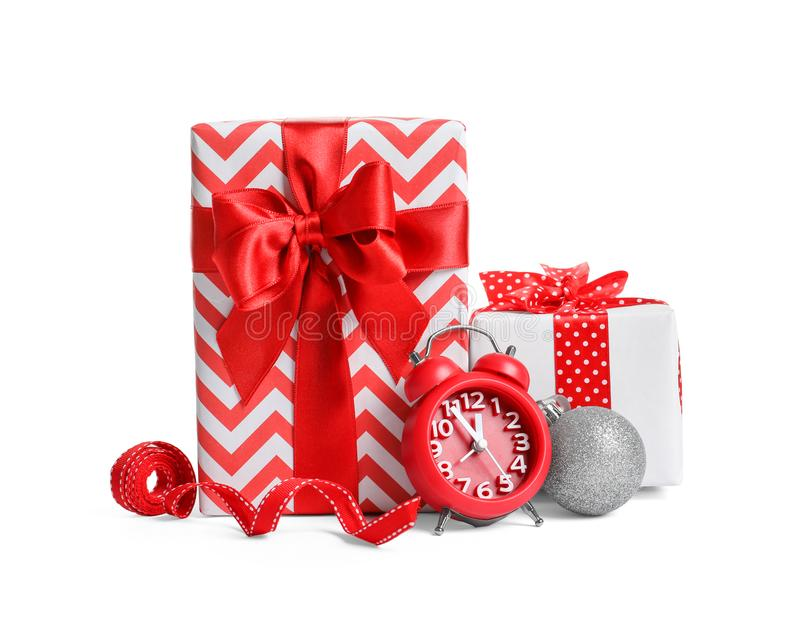 Beautifully wrapped gift boxes, alarm clock stock photos