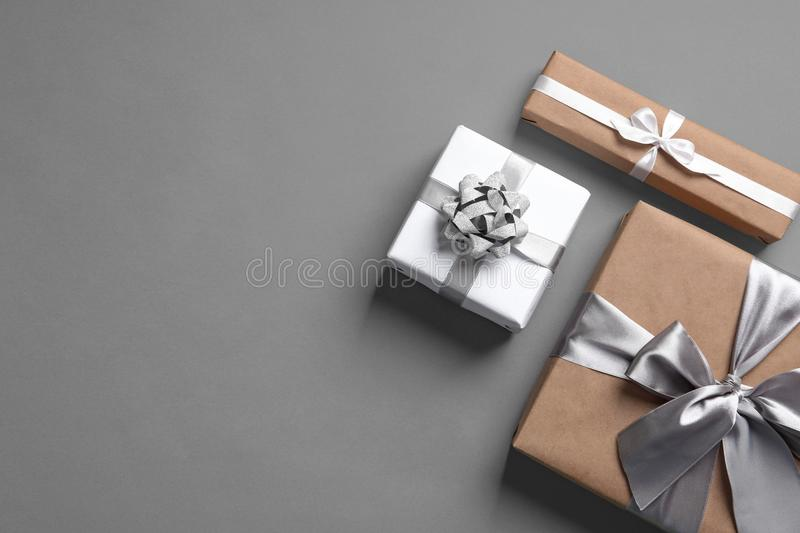 Beautifully wrapped gift boxes on grey background stock photography
