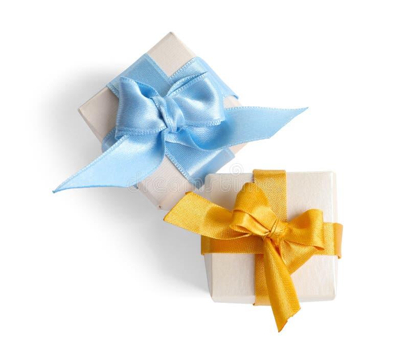 Beautifully wrapped gift boxes on white background stock photo