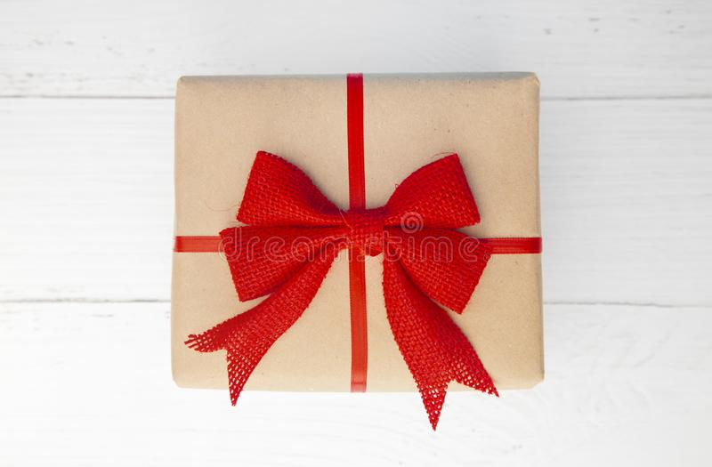 Beautifully Wrapped Gift with Kraft Paper stock photography