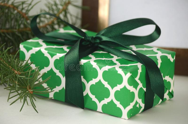 Christmas gifts and presents gift wrapped box with copy space beautifully wrapped holiday presentristmas gift boxes with copy space coniferous tree branch negle Image collections