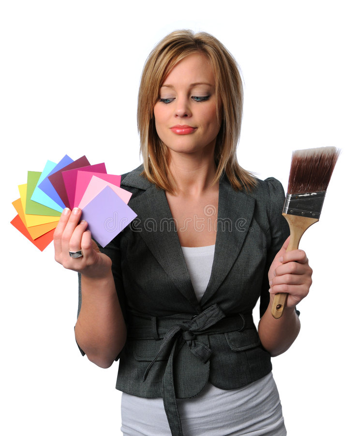 Beautigil Girl With Brsuh and Color Swatches. Gorgeous girl with paint brush and color swatches royalty free stock photo