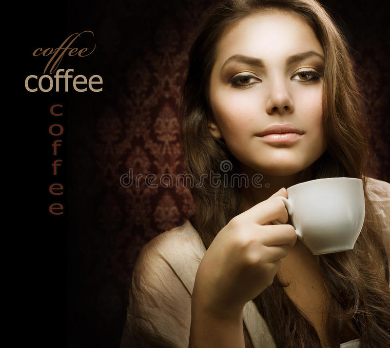 Beautuful Woman with cup of Coffee. Beautiful Young Woman drinks Coffee.Isolated on black.With Space for Your Text royalty free stock photos