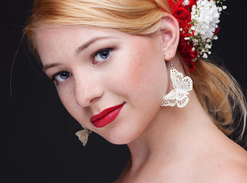 Beauty. Beautiful woman with bright make-up on black background stock photo