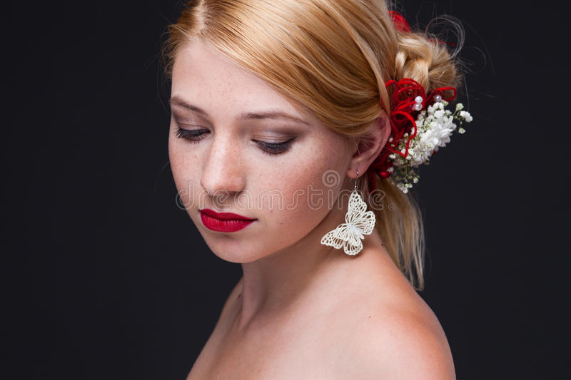 Beauty. Beautiful woman with bright make-up on black background stock image