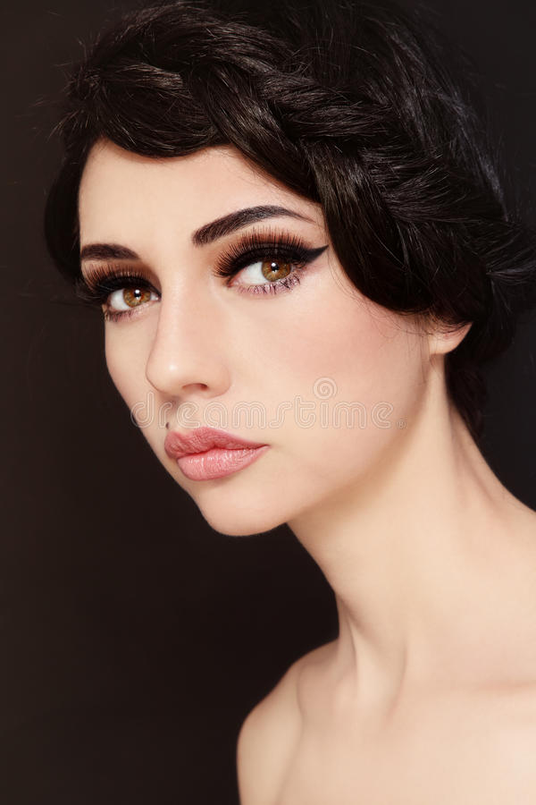 Beauty. Portrait of young beautiful woman with stylish make-up and hairdo royalty free stock images