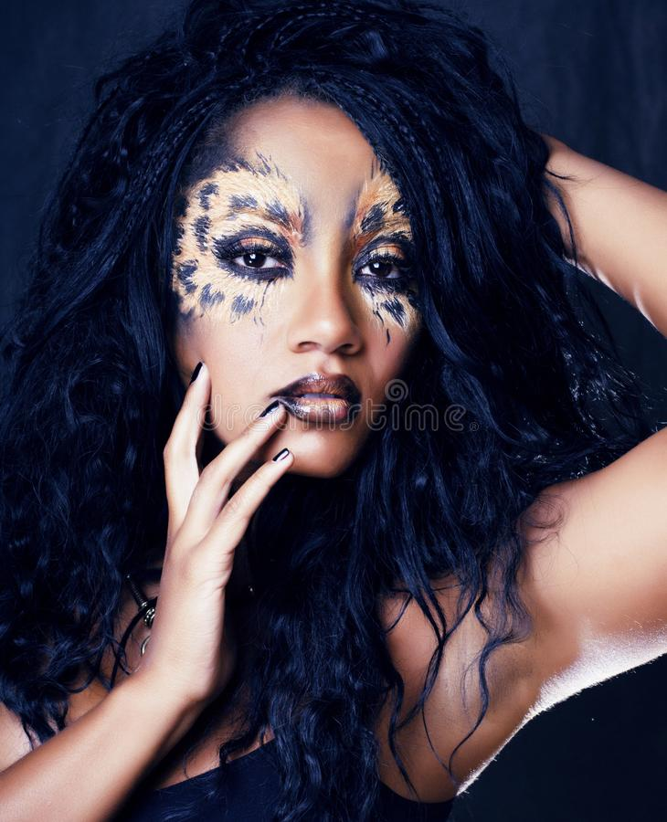 Beauty afro girl with cat make up, creative leopard print closeu. P halloween close up stock image