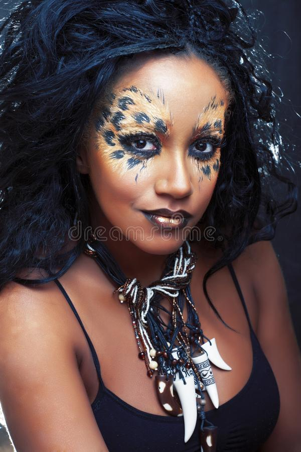 Beauty afro girl with cat make up, creative leopard print closeup, fashion style halloween look royalty free stock images
