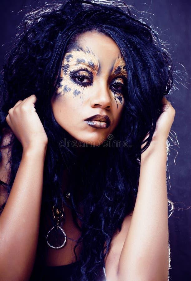 Beauty afro girl with cat make up, creative leopard print closeu. P halloween close up stock photo