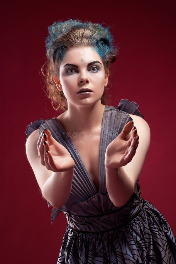 Beauty alien woman in futuristic dress